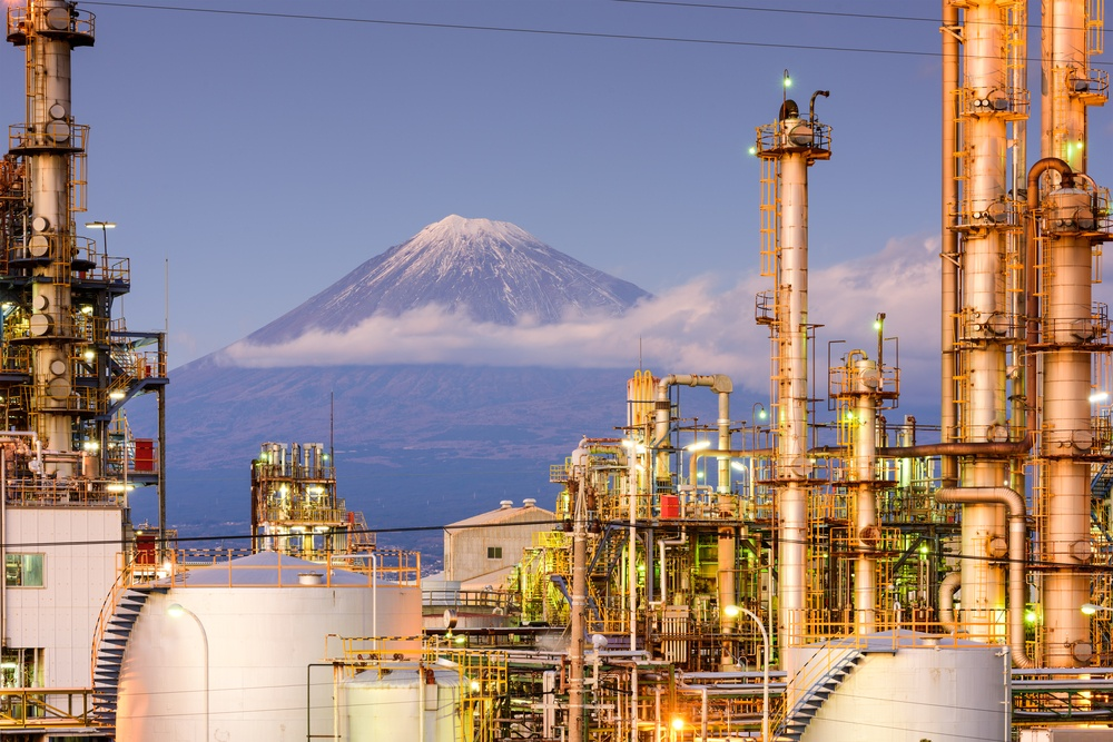 Mt. Fuji, Japan viewed from behind factories.